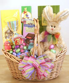 Easter basket filled with chocolate and a stuffed bunny toy.