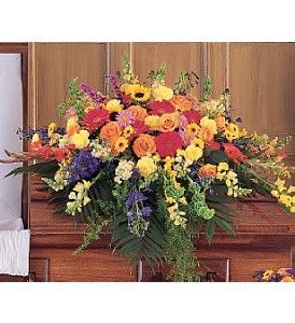 Celebration of life casket spray vibrant casket spray in an assortment of flowers izmirmasajfo