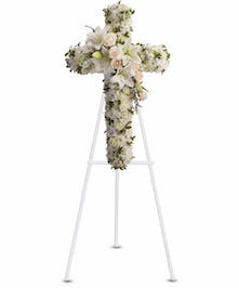 Sympathy cross of creme roses, white spray roses, oriental lilies, stock and more.