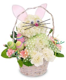 Easter bunny made of spring flowers in a white handbasket.