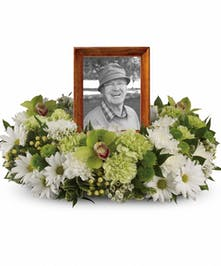 Sympathy wreath of white and green flowers to surround a framed photograph or urn.