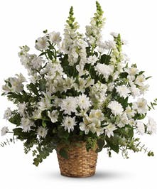 Sympathy basket of all-white flowers and assorted greenery.