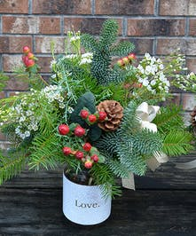 Holiday bouquet of hypericum berries, wax flowers, and seasonal evergreens