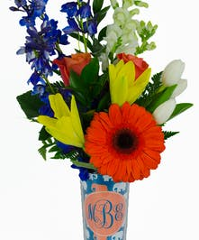 Custom tall travel mug filled with complementary flowers.