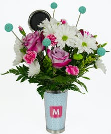 Custom travel mug filled with complementary flowers.