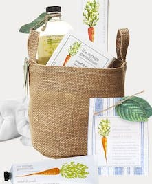Jute bag filled with various spa items.
