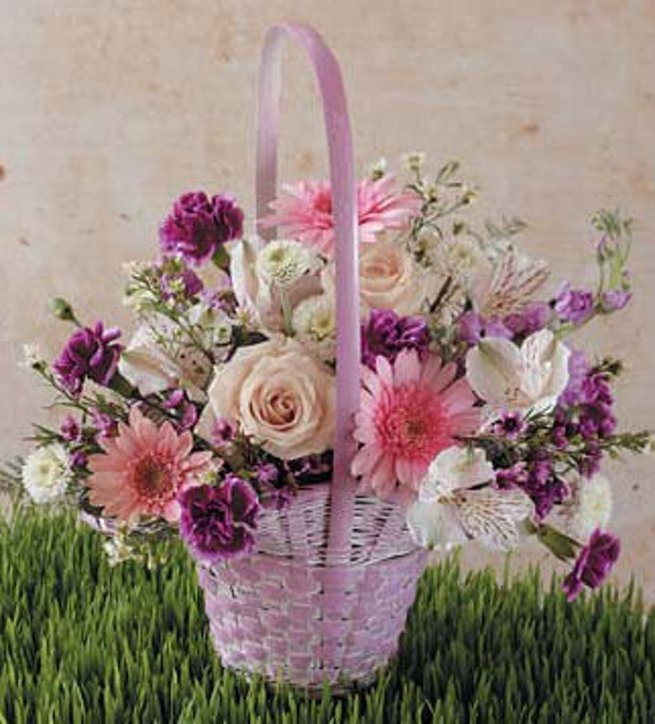 Pastel easter flowers julias easter flower delivery wilmington pink handbasket filled with pink and purple flowers izmirmasajfo