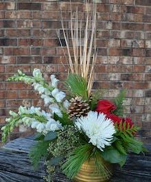Gold ceramic vase of snapdragons, roses, Fuji mums, and seasonal evergreens