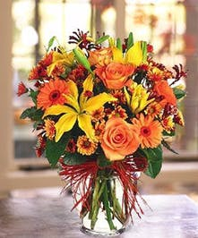 A classic fall bouquet designed in a vase