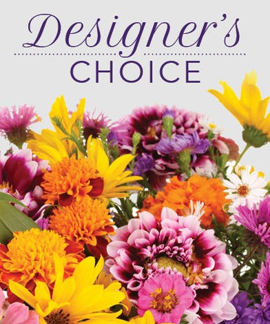Image of a flower arrangement with yellow and purple flowers with text that reads: Designer's Choice.