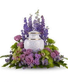 Lavender and green sympathy flower arrangement to surround an urn or photograph.