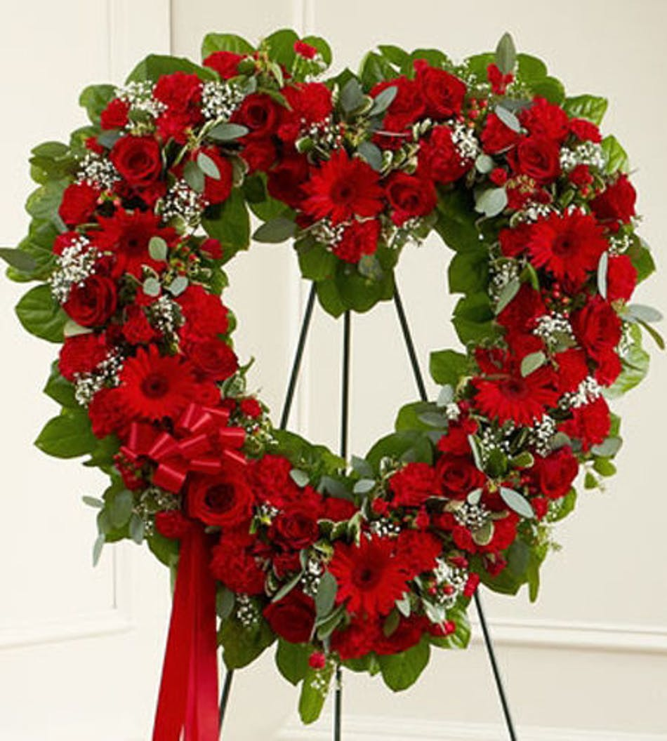 Red floral funeral heart tribute wilmington nc delivery sympathy heart of red flowers and assorted greenery displayed on an easel with matching red ribbon izmirmasajfo
