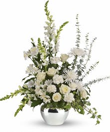 Silver jardinere vase of white roses, alstroemeria, carnations and more.