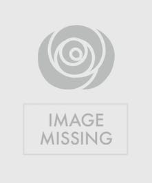 Mini carnations, daisies, lilies, and baby's breath in a wicker basket.