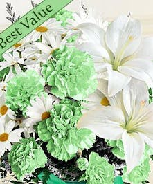 Closeup of green carnations and white lilies and daisies.