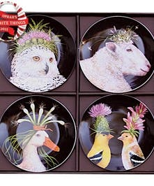 Set of four appetizer plates decorated with whimsical animals.